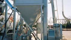"""1991–Jet Pulse Dust Control The Vince Hagan designs an affordable """"jet pulse"""" dust collection system for the concrete industry."""