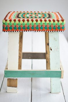 Crochet stool display - muted colours - recycled
