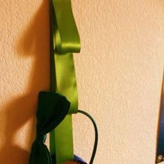 Easy way to store your headbands, just nail some ribbon and hang away!