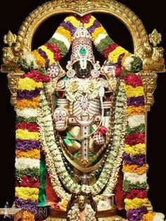 This Deity of Lord Vishnu, an expansion of Lord Krishna, is also known as Venkateshwara or Balaji, the Lord of seven hills at Tirupati. He holds a chakra (disc) and shankha (conch) in two hands and blesses devotees with the other two. Shri Ganesh, Lord Ganesha, Lord Shiva, Sai Baba Pictures, God Pictures, Om Namah Shivaya, Tirumala Venkateswara Temple, Indian Temple, Lord Balaji