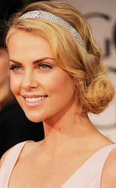Charlize Theron looking a-mazing with an amazing wavy side chignon and stunning jewel embellished headband