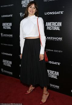 Showing some skin: Emily Mortimer flashed a sliver of her flat stomach in a cropped white ...