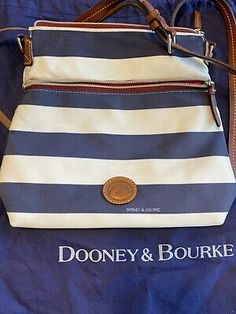<p>Dooney And Bourke Nylon Crossbody. Condition is Pre-owned. Shipped with USPS Priority Mail. Shows signs of use on front and back on white parts. Good used condition.</p> Dooney And Bourke Wristlet, Dooney Bourke, Wristlet Wallet, Priority Mail, Signs, Best Deals, Leather, Ebay, Shop Signs