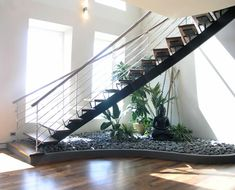 If you have an empty space under the stairs in your home, then maybe you can use this space for an indoor garden. And not any type of garden, but a small pebble garden that will Small Garden Under Stairs, Space Under Stairs, Jardin Zen Interior, Zen Interiors, Pebble Garden, Inside Garden, Stair Decor, Modern Stairs, Modern Mansion