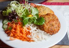 Tyrolean Kaspressknödel - a delicious fried dumpling with cheese served with a mixed salad