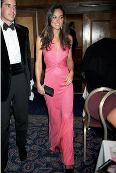 Catherine, Duchess of Cambridge in a figure-hugging silhouettes slinky gown by Issa as she attends to a charity ball in 2008.