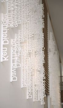 laser-cut styrofoam names. The headquarters of Ziba Design, a design consultancy in Portland. The lobby features an installation of employee names laser-cut from wafers of Styrofoam and hung vertically according to date hired. Environmental Graphic Design, Environmental Graphics, Wayfinding Signage, Signage Design, Office Signage, Typo Design, Donor Wall, Co Working, Commercial Interiors