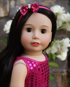 18 Inch Doll Melody Rose is the same size as American Girl Dolls. She has poseable limbs, open close eyes and realistic premium wigged hair. Visit her at http://www.harmonyclubdolls.com