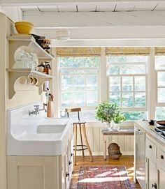 Antique kitchen sink in an adorable, sunny cottage kitchen.