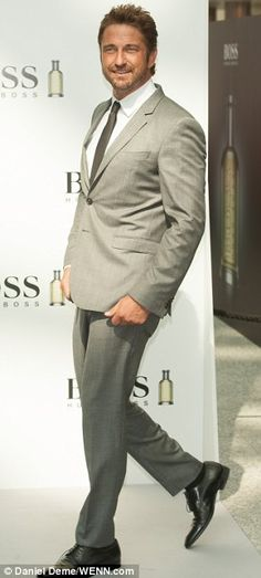 Dapper: The Scottish actor wore a light grey suit as he was unveiled as Boss' latest celebrity ambassador