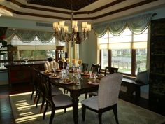 The formal dining room is located right next to the kitchen. The dining room table can comfortably seat 8 people.  Notice the Qing Dynasty cabinet in the background. The cabinet is both functional and aesthetic, providing both storage and a luxurious look.