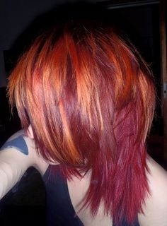 Red/orange hair. Color not cut