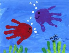 hand print fish-color w chalk/chalk pastels for water, finger dipped in white tempura spread over chalk