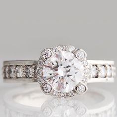 Statement Halo Engagement Ring.... Soo cute... I want it