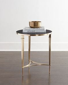 "Brock Side Table Global Views  Brock Side Table  $1,199.00    25% off : $899.25  Online Inquiries: HCF17_H7NSP    Side table handcrafted of brass and granite.  French square legs.  21.5""Dia. x 26""T.    Read more at http://www.horchow.com/Global-Views-Brock-Side-Table/cprod111400033/p.prod#LbW2Kbyux0daoP0y.99"