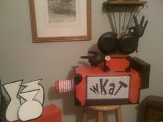 Several boxes and paper plates glued, taped and painted to look like movie camera for Seussical the Musical Jr