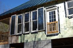 It's March of '07. South elevation. Homemade solar panels generate a surprising amount of heat on a sunny day. Built with mostly reclaimed materials. Air to air system runs with small dayton fan and simple thermal snap switch cutting on at 120 degree This occasion we will be able to determine our future. The planet needs green energy and saving cash in our electrical bill Visit http