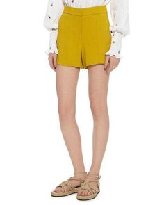 Outfit ideas for high-waisted shorts and our favorite pairs right now: A pair of elegant ALC Cohen shorts in a pretty citrine