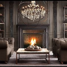 Greige livingroom with chesterfield sofas, fireplace and a theatrical crystal chandelier #interiordesign - More wonders at www.francescocatalano.it