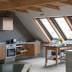 Kitchens can be created in all sorts of spaces in your home like this attic conversion. Wall hung units and freestanding pieces help to create a sense of light and space in the compact area whilst the wooden units mimic the wooden beams and windows creating a coordinated unity.  http://www.housetohome.co.uk/kitchen/picture/wooden-beamed-modern-kitchen