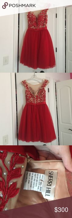 Sherri Hill homecoming dress Sherri hill bright red homecoming dress. It is gorgeous. In perfect condition and lightly worn for one night. Negotiable on price just leave me an offer! Sherri Hill Dresses