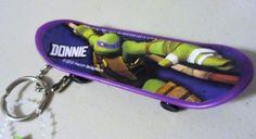 Teenage Mutant Ninja Turtles Donnie Skateboard Keychain, http://www.amazon.com/dp/B00EK9O6JS/ref=cm_sw_r_pi_awdl_AEL4ub0A9KJFR