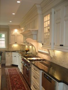 Love the white tile back splash and the dark hardware on the cabinets.  Traditional kitchen by Bradford Design LLC