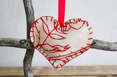Lana Red Studio: Felt Christmas Ornament DIY.  Don't have felt, but could use the bags from Charming...