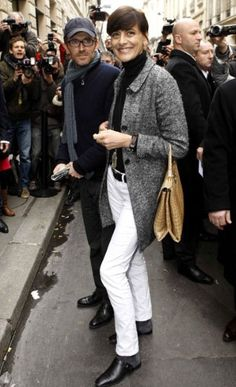 WHITE JEANS...Inès de la Fressange sports a chic pair of drainpipes outside the Chanel show.