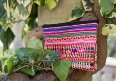 "This stand out clutch is handmade using one of a kind tribal fabric, with bead tassels. It is fully lined with an internal pocket and zip closure.It measures approximately 9.5""x7""Due to the use of vintage fabrics, there may be slight imperfections. This only adds to the character of the bag, making it even more unique."
