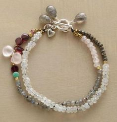 Galaxy Bracelet by Nicole Ardis Jewelry Two strands strung with garnet, rose quartz, labradorite, rainbow moonstone, turquoise and pyrite. Sterling silver toggle.