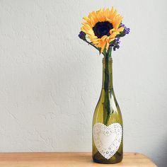 Done with that bottle of wine? Remove the label, and get a paper doily from the dollar store to complete this cute DIY. Source: Sarah Lipoff