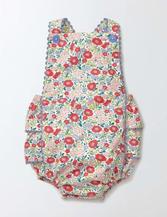 This playsuit features a ruffled bottom and rickrack edges, for a little touch of traditional cuteness. Its soft cotton material is perfect for layering over a body. Poppers make dressing easy, while adjustable buttons on the straps means the suit can be lengthened as your baby grows from tiny to slightly-less-tiny.