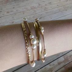 set-of-four-wire-wrapped-gold-and-pearl-bangles