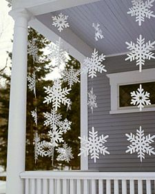 Although these oversize snowflake streamers look delicate, they're made  from a sturdy material that allows them to withstand wet weather.