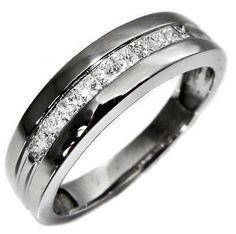 Men's wedding band idea...dark with square cut diamonds. Masculine, but he gets what he wants too.