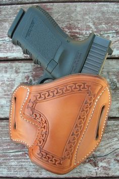 Gibson Gunleather holster. Premium Hermann Oak American leather, natural with white stitching. Hand-stamped San Carlos beaded border. For Glock 19, 23, or 32.  www.BruceGibsonDesign.com