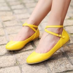 Loving these yellow ballet flats with the simple straps!