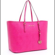 Hot Pink Michael Kors Jet Set Tote Hot Pink Michael Kors Jet Set Tote! It has a middle zipper that can fit a laptop! Also includes the MK emblem  a great Everday tote for work, school or day time fun! I use to work at Michael Kors and the Jet Set Tote was one of our best sellers! *Dont Miss Out* Michael Kors Bags Totes