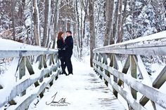 Engagement Session - Couple on Snowy Bridge
