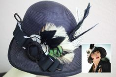 Phryne wears this hat whilst roaming the cemetery in 'Death Comes Knocking' (Series 2, Episode 2). A deep and sombre hat, the hint of green lifts the black and white feathers.