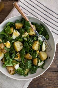 Garlic Roasted Potato, Spinach, and Egg Salad. would probably be good with sweet potato, kale and soft-boiled egg too.