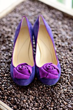 Pretty Purple pumps poised on pack of coffee beans?  love it!