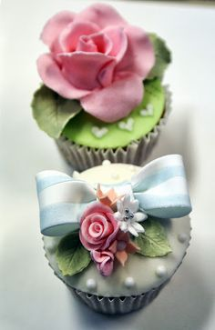 Cupcakes  with  roses and a blue striped bow