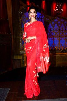 Deepika Padukone is equally at ease pulling off a bikini or a sari. With her statuesque figure and grace – she always looks regal and elegant which her peers try hard to emulate. She's out promoting Finding Fanny, her latest film and she was spotted looking resplendent wearing a red sari. If you're heading for a sangeet ...