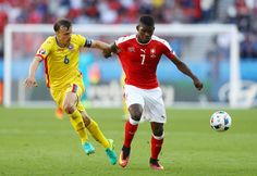 Breel Embolo of Switzerland and Vlad Chiriches of Romania in action during the UEFA EURO 2016 Group A match between Romania and Switzerland at Parc des Princes on June 2016 in Paris, France. Uefa European Championship, European Championships, Uefa Euro 2016, Fifa World Cup, Paris France, Switzerland, June, Action, Group