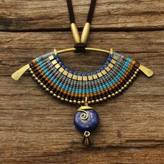 Woven tribal necklace with lapis lazuli set into brass dangl.- Woven tribal necklace with lapis lazuli set into brass dangle Woven tribal necklace with lapis lazuli set into brass dangle - Macrame Colar, Macrame Necklace, Tribal Necklace, Macrame Jewelry, Tribal Jewelry, Wire Jewelry, Boho Jewelry, Jewelry Crafts, Jewelry Accessories
