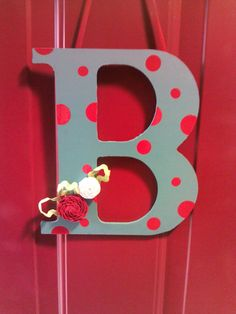 Wooden letter from hobby lobby, vinyl polka dots cut using cricut, rick rack flowers= door hanger! find rick rack flower tut here http://matildajaneblog.com/ric-rac/
