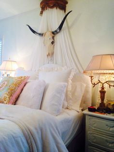 This is an interesting look. However I'm not sure I would want an animal skull right above my bed, but I do like the contrast of the skull with the frilly romantic bedding. It's very fantasy-like, yet mildly disturbing.