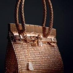 $2,000,000 for the rose gold and diamond crocodile skin Hermes Birkin.These Hermes  Bags each have 2,712 diamonds and are ONLY 6 inches tall.  While the regular run-of-the-mill Hermès Birkin bag is five figues and above, and has a multiple-year-long wait list, this small bag kicks it up a notch for the ultra rich.